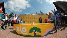 two people play table tennis on a artworked ping pong table by POPP in rio at the 2016 summer olympics