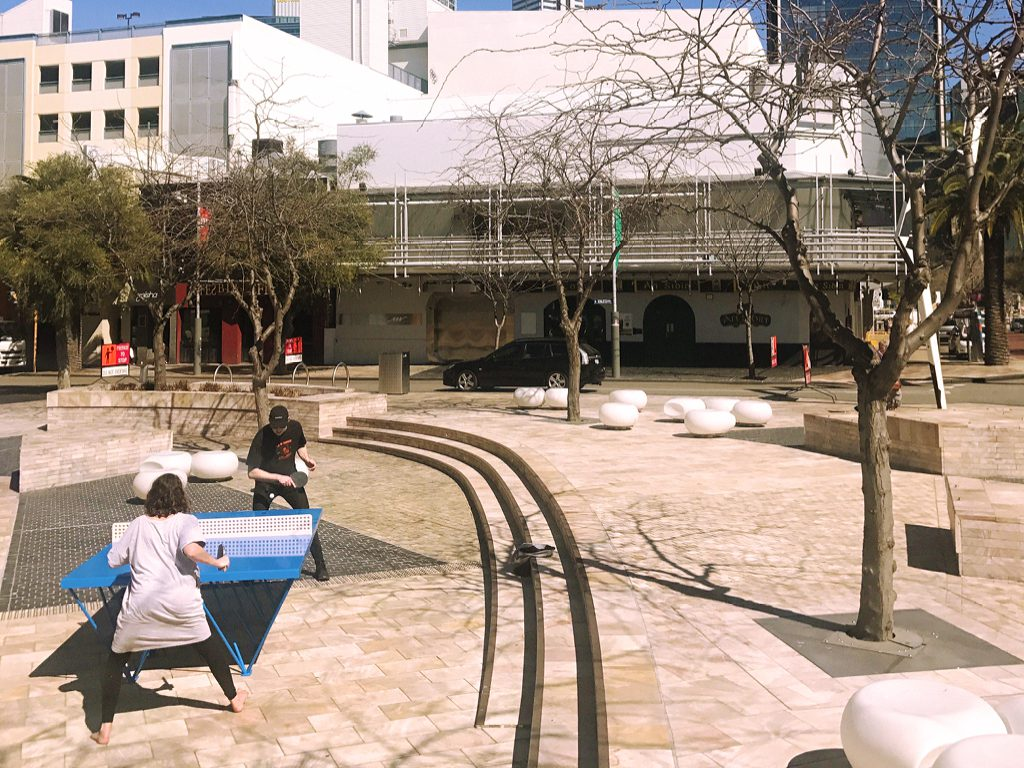 People playing ping pong at a temporary outdoor activation at Northbridge Piazza Perth