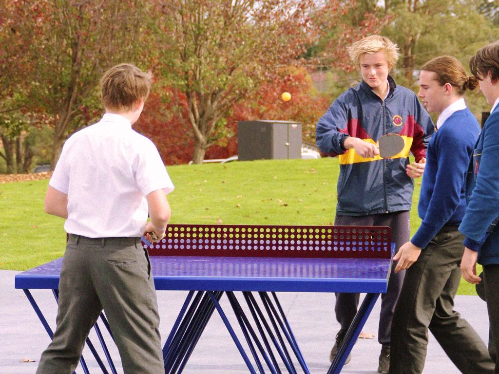 Boys playing outdoor ping pong on a POPP ICON table at St Paul's Anglican Grammar School in Victoria