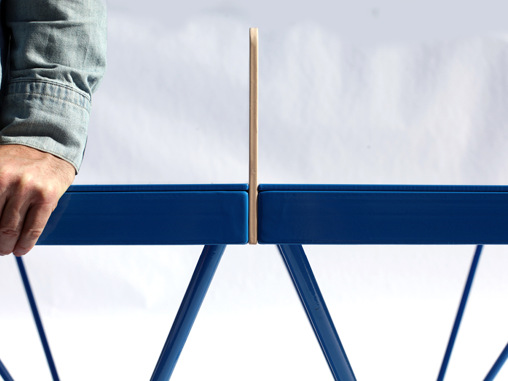Close up side view of the POPP ICON outdoor ping pong table steel net and frame