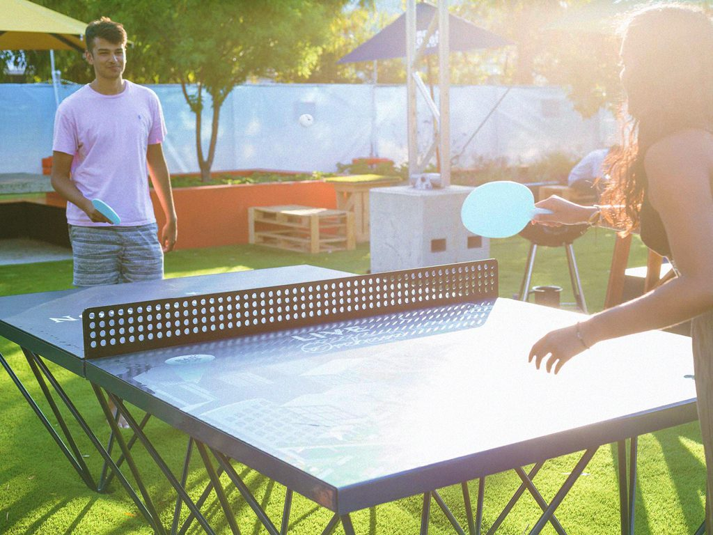 People playing ping pong on a POPP ICON table at the Urban Orchard in Perth