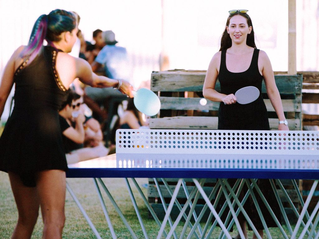 Girls playing outdoor ping pong at pop-up bar by Embargo in South Perth