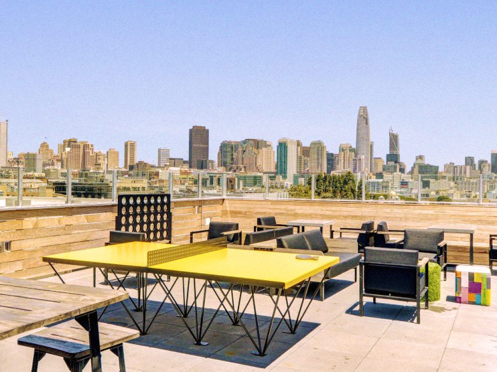Rooftop installation of a POPP ICON outdoor ping pong table at L Seven Apartments San Francisco