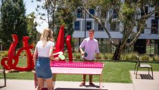 Two students playing a game of table tennis on one of four POPP HERO tables at the University of Canberra