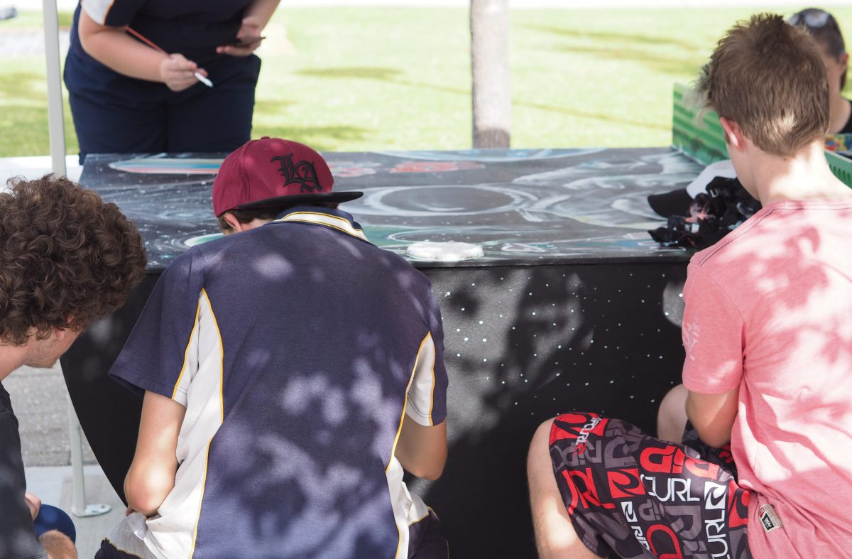group of children painting a steel pink pong table in Ellenbrook Western Australia